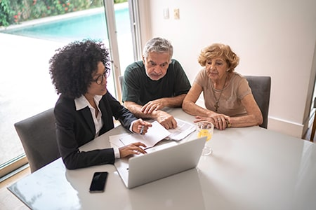 Finance Specialist Discussing Home Improvement Loan with Couple